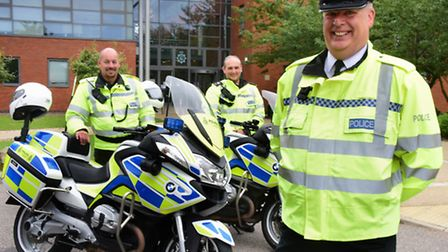 Chief Inspector Chris Spinks, right, head of roads policing in Norfolk and Suffolk, with two police