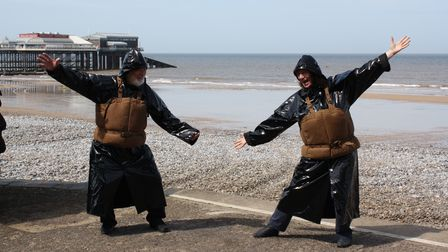A group of volunteers have donnedhistorical lifesaving gear and walked a mile around Cromer to raise money for theRNLI.