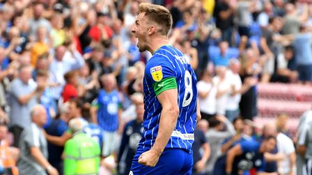 Wigan Athletic's Lee Evans celebrates scoring his side's third goal of the game during the Sky Bet C