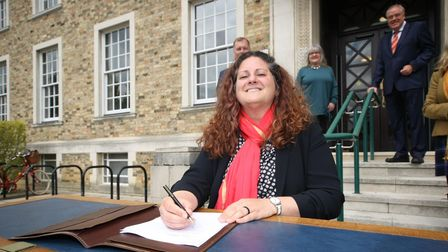 Cllr Elisa Meschini (Lab) signing the alliance agreement to run the county council.