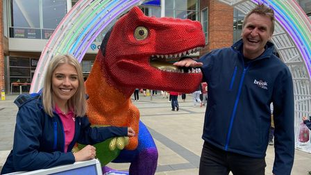 Eleanor Edge and Peter Marron from Break with the T-Rex sculpture outside Chantry Place