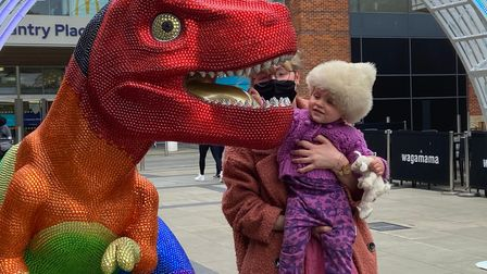 A youngster enjoying the Prideasaurus moments after it was revealed at Chantry Place in Norwich