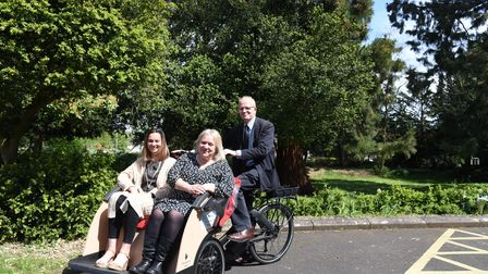 Jenny Day, Joe Reeder CEO and RObert Horn from Red Gables. A new rickshaw is being launched to help