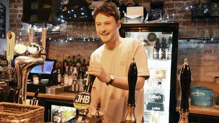 James Stoten pulling a pint. Oakes Barn pub in Bury are preparing to re-open Picture: CHARLOTTE BON