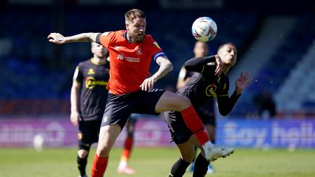 Luton Town's Sonny Bradley (left) and Watford's Joao Pedro during the Sky Bet Championship match at