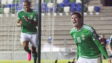 Northern Ireland's Kyle Lafferty (centre) celebrates scoring his side's first goal of the game durin