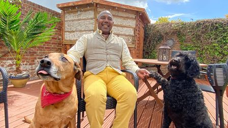 Lord Wesley Pestado with his two dogs, Siddy and Bella