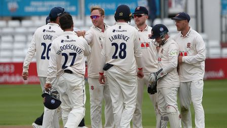 Simon Harmer of Essex celebrates taking the wicket ofDerbyshire's Wayne Madsen at Chelmsford
