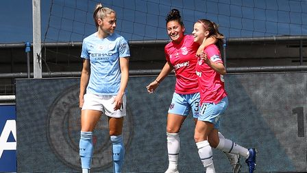 West Ham United's Anouk Denton (right) celebrates scoring their goal against Manchester City in the Women's FA Cup