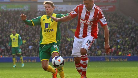Wes Hoolahan of Norwich and Jonathan Walters of Stoke in action during the Barclays Premier League m