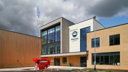 A modern school building with the words Paxman Academy on