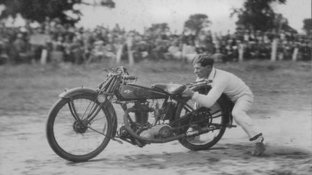 Tricky Newman holds on to the back of his motorbike.