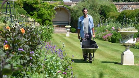 Head gardener Sam Garland with the herbaceous borders of the Bishop's Garden which is opening as loc