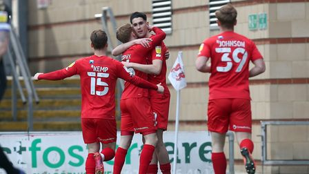 Conor Wilkinson of Leyton Orient (9) scores the first goal for his team and celebrates with his team