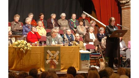 Speakers address a packed Corn Exchange, Ipswich, for the Women's Institute Federation Council meeting in 2006