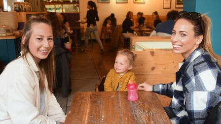 Sisters Elysse Bell, left, and Charlotte Lightfoot with her daughter two-year-old Poppy, enjoying be