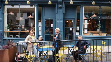 Visitors to Norwich sit outside the busy Cafe 33 at Exchange Street. From left, Amarina Fakir, Mark