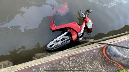 The Honda Vision 110CC moped being pulled out of the water