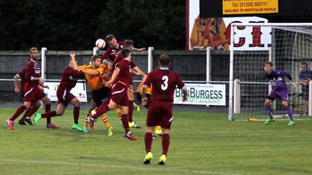Action from Kirkley & Pakefield's 1-0 win at Fakenham Town, orange, last weekend. Picture: TONY MILE