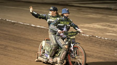 Jason Crump waves to fans as he celebrates the Witches victory with team-mate Drew Kemp.