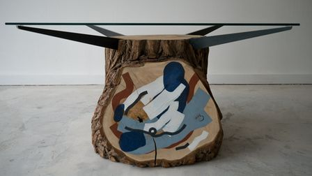 A table made by Adam from a tree stump