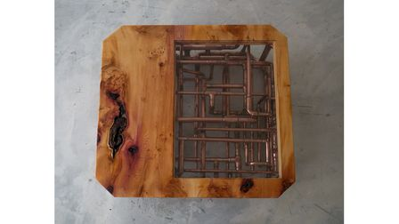 A table made by Adam from copper pipping, glass and wood