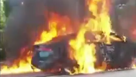 Video footage shows the terrifying moment a Jaguar car burst into flames along the A47 Thorney Toll.
