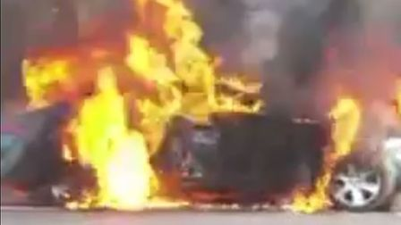 The Jaguar XF engulfed in flames on the A47 Thorney Toll.