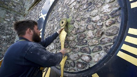 Repair work gets underway to the North side of Cromer Parish Church's clock face. Pictured is Jack H