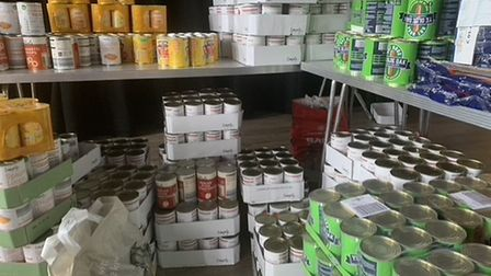Tinned items being placed into half-term food hampers.