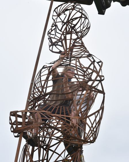 Pakefield Man a sculpture by artist Tobias Ford is installed at Potton Hall near Saxmundham for the