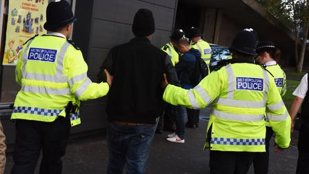 Police carrying out a stop and search operation.