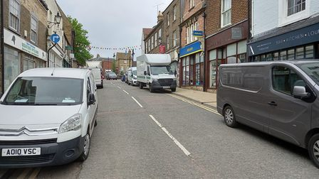 'seven vehicles parking on double yellow lines' atForehillin Ely.