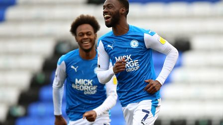 Peterborough United's Mohamed Eisa (right) celebrates scoring their side's sixth goal of the game du
