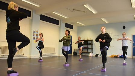 Nicole Cotee, dance instructor at Centre Stage, back teaching the youngsters as the community groups
