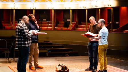 Owen Calvert-Lyons working with actors on stage at the Theatre Royal Bury St Edmunds