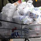 Generic picture of Tesco carrier bags in a shopping trolley.