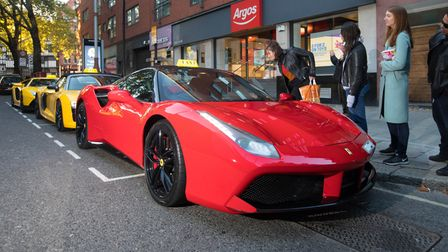 EMBARGOED TO 0001 TUESDAY OCTOBER 2EDITORIAL USE ONLYA Ferrari 488 Spyder lines up outside Argos