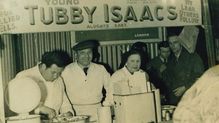 1919-2013... Tubby Isaacs' jellied eel stall in Petticoat Lane in its 1950s heyday...Ted Simpson, Solly and Patsy Gritzman.
