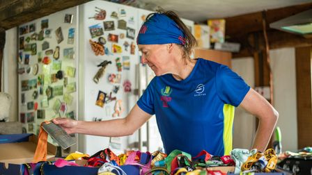 Karen loooking through all her medals. Picture: Sarah Lucy Brown