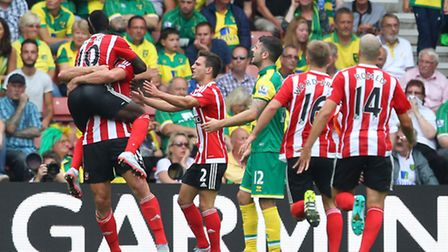 1 - Sadio Mane congratulates Graziano Pelle on scoring Southamptons opener against City. Pictures by