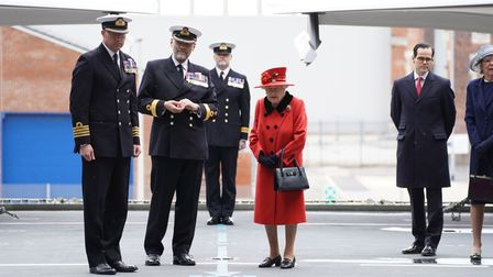 Captain Angus Essenhigh (left), Commodore Steve Moorhouse (second from left) and Queen Elizabeth II