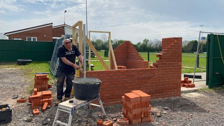 Framlingham Town FC'sticket booth is being rebuilt after a fire last December