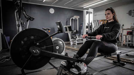The Live Well With Leigh gym studio. Leigh on the rowing machine in the gym.
