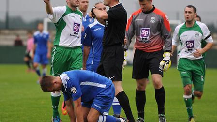Players from both teams surround referee Anthony Tankard after Adam Nicklin of North Ferriby United