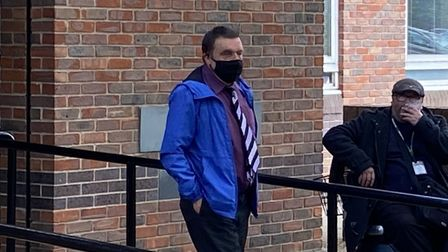 David Skipper (in blue jacket) leaving Norwich Magistrates Court after admitting drink driving on a scooter.