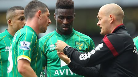 Graham Dorrans, Alex Tettey and Martin Olsson deep in discussion with manager Alex Neil at West Ham.