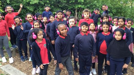 Smiling pupils at the Poplar school shortlisted for a national award.