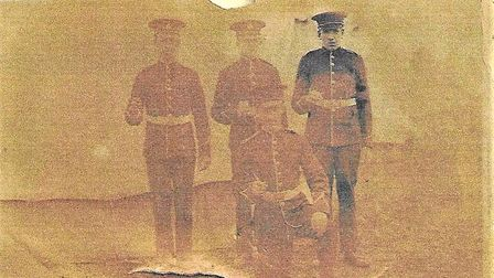 Corporal Arthur Rawson, from Whittlesey, kneels at the front of this photograph