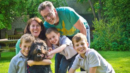 Mum and dad Cheryl and Paul with their three sons Edward, Miles, and Lucas and family pet dog, of course